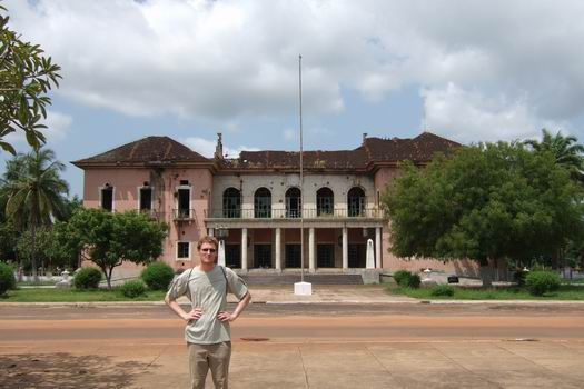 "The tourist version of myself in front of the ruins of the former Presidential Palace in Bissau - okay I doubt it really could pass a litmus test for using the word ""palace"" in its golden age. The palace was destroyed during the civil war back in 1999 and the rumors tell that the president doesn't want to rebuild it and move in because it is thought be home for bad spirits."